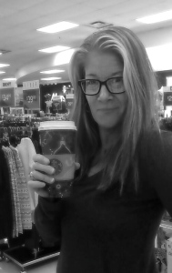 Image is a black and white photo of me wearing glasses and holding a cup of coffee